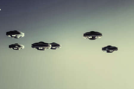 abduction: ufo spaceships flying in the sky Stock Photo