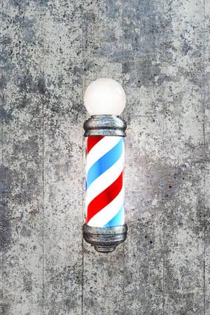 sign pole: barber pole on concrete wall