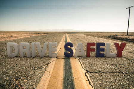 desert road: 3d illustration of drive safely sign on a desert road