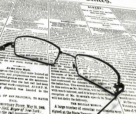 old newspaper: 3d illustration of eyeglasses on old newspaper