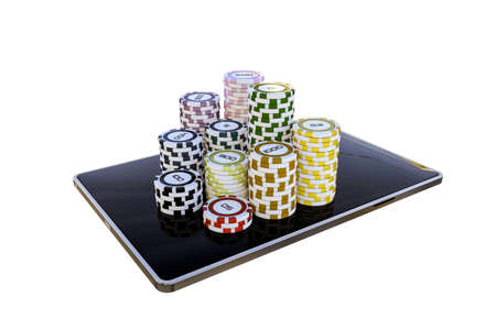 modern tablet with poker chips isolated on white background Stock Photo