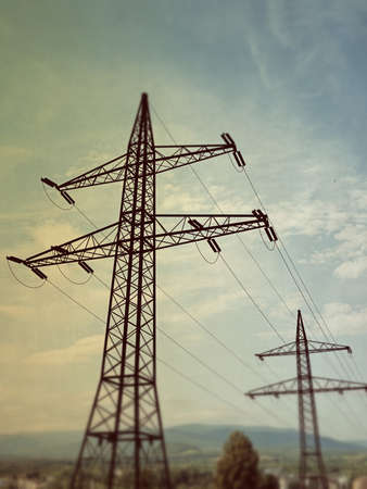 3d illustration of electric pylons in country background Stock Photo