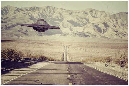 3d illustration of an unidentified flying object crossing an empty desert road Stock fotó