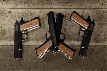 guns on concrete floor 3d illustration Stock Photo