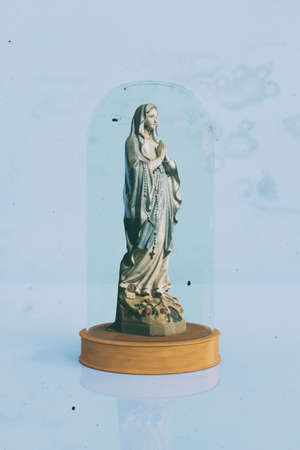 Mary statue isolated on blue background 3d illustration Фото со стока