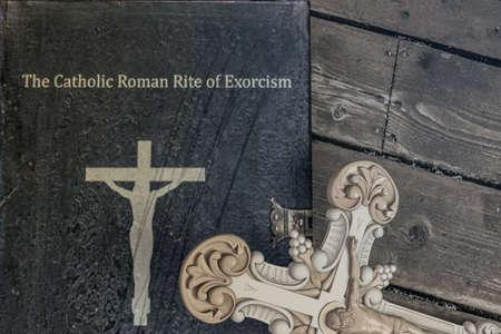 exorcism book on wooden floor 3d illustration Фото со стока