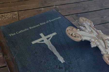 exorcism book on wooden floor 3d illustration Stock Photo