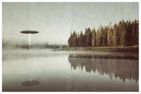 unidentified flying object take off over a lake 写真素材