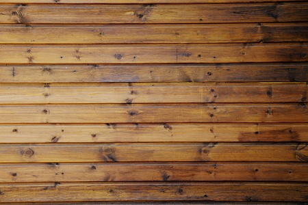 Abstract background of brown wooden planks showing natural grain and knots and parallel pattern Stock Photo
