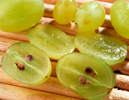 Closeup of sliced fresh juicy green table grapes showing the pips and inter flesh Stock Photo - 15471571