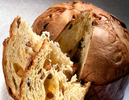 Slices of freshly baked Christmas panettone cake, a sweet bread with a fluffy texture made with orange, zest, raisins and spices popular in Italian cuisine