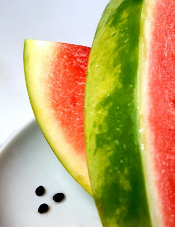 Closeup of sliced fresh watermelon showing the green rind and sweet pink flesh with its refreshing high water content Stock Photo - 15471644