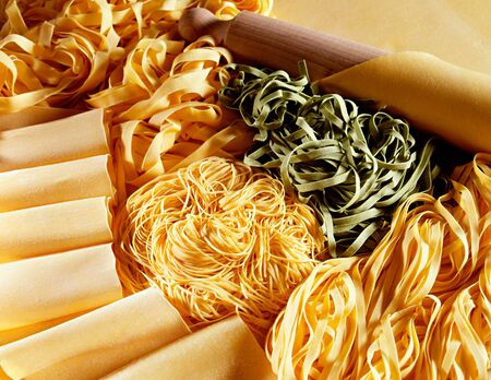 Display of a wide variety of different raw handmade Italian pastas used in cooking Mediterranean cuisine Stock Photo - 15471699