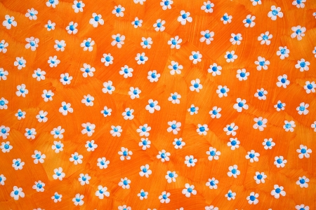 centres: Bright orange floral background with scattered white flowers with blue centres on a vibrant orange backdrop