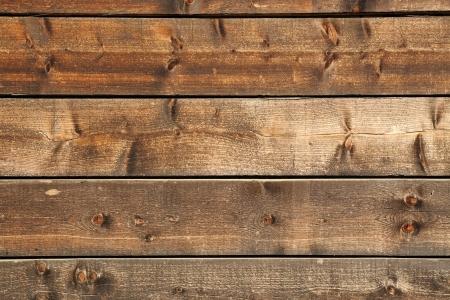 거친 질감 표면과 woodgrain 세부 사항과 병렬 수평 매듭 목재 보드의 건축 배경 스톡 콘텐츠