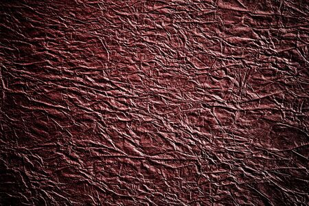 Abstract background of crinkled and crumpled dark brown paper texture with vignetting Stock Photo - 16186169