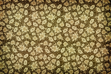 Background of brown vintage floral wallpaper with a closely packed pattern of flower heads Stock Photo