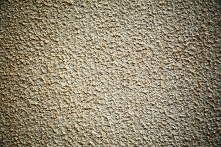 stippled: Abstract background of a dirty rough stippled wall surface with corner vignetting