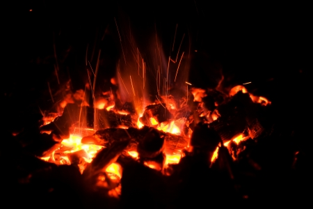 Glowing hot charcoal fire providing heat and energy using a natural sustainable resource and fuel Stock Photo