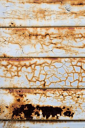 Abstract background texture of grunge rusty painted metal with cracked discoloured white paint stained by the rust and corrosion Stock Photo - 16598475