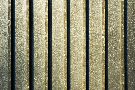 galvanised: Abstract background of a reinforced metal gate background of galvanised steel with vertical reinforcing rods