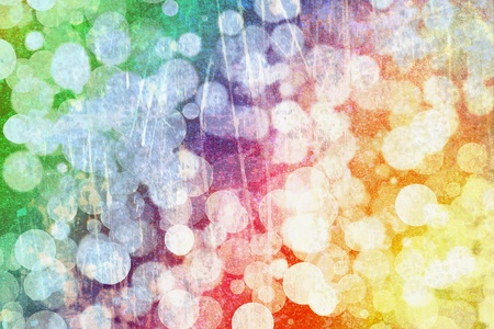 muted: Abstract background bokeh with spherical shapes overlying the muted colours of the rainbow or spectrum