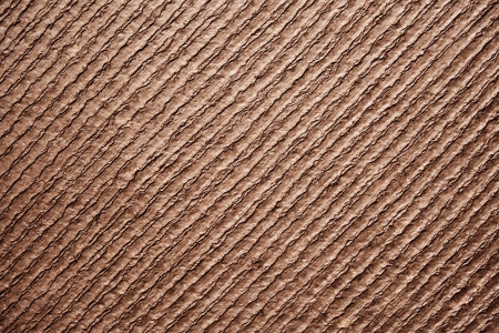 ridged: Rough textured ridged brown paper background with fibre detail and parallel diagonal lines