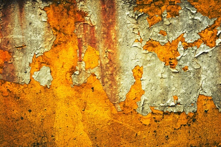 suface: Abstract background texture of remnants of a grungy paper label or notice on a weathered painted orange suface Stock Photo