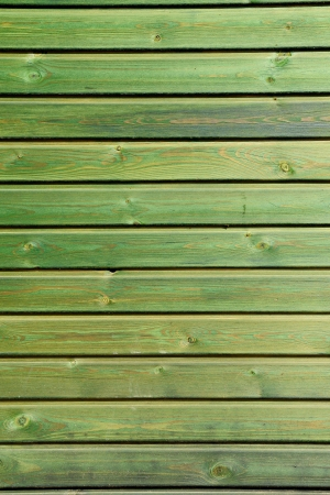 treated board: Abstract background of treated and stained green boards or planks in parallel horizontal rows Stock Photo
