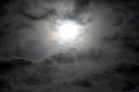 Full moon shining through a thin layer of clouds in the night sky suitable as a Halloween background photo