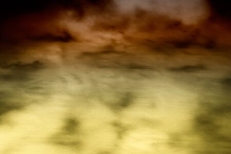 Blurred abstract background with blended shadows and highlights in brown and pale gold