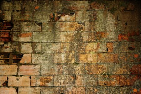 residue: Abstract background of an old grungy brick wall with cement, paint and plaster residue and staining Stock Photo