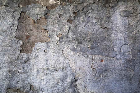 flaking: Abstract architectural background texture of a grungy wall with damaged dirty stained flaking plaster