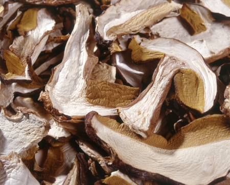 flavouring: Background closeup of sliced dried mushrooms for use as a flavouring ingredient in cooking