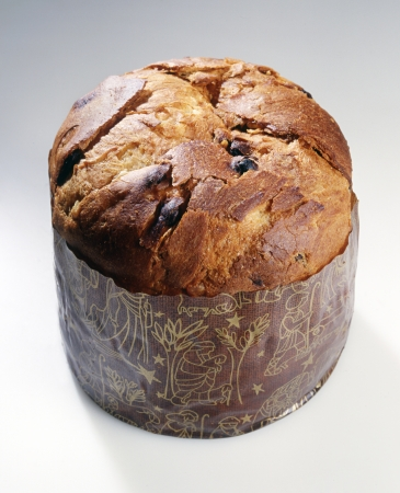 Panettone Christmas cake is a traditional Italian sweet bread cake made from sour dough for fluffiness with citron, spices, candied fruit and raisins usually baked in a cupola shape Stock Photo - 17474606