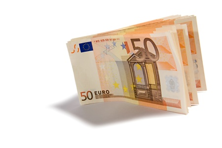 denominational: Wad of 50 Euro banknotes standing upright on a white background casting a shadow to the front with copyspace
