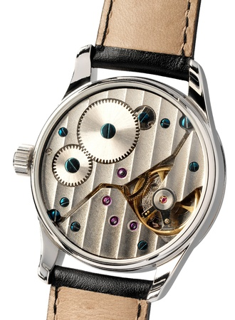 escapement: Wristwatch with the back cover removed displaying the mechanism with its gears and escapement isolated on white Stock Photo