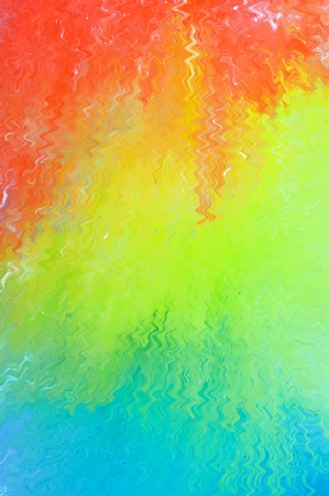 Vivid abstract background in tropical colours graduating between turquoise , green and orange with a textured paint effect Stock Photo