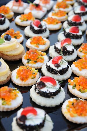 banquet: Display of colourful individual gourmet appetizers on a buffet table at a banquet or upmarket catered event Stock Photo