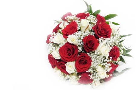 Beautiful red and white roses in a bridal bouquet symbolising everlasting love on a white background with copy space