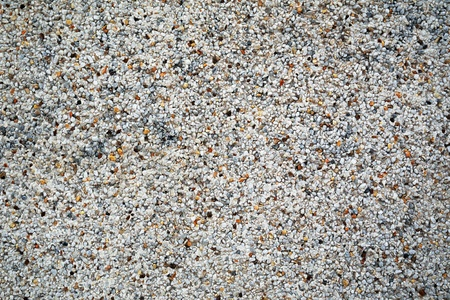 stippled: Gravel wall texture with a covering of small stone chips giving an attractive mottled rough textured finish