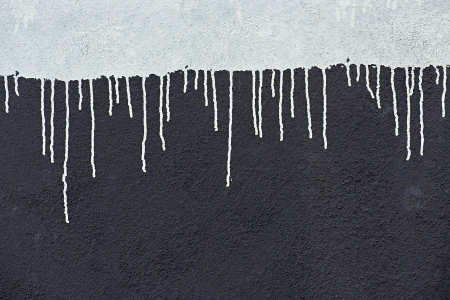Gray paint drops on a dark gray wall photo