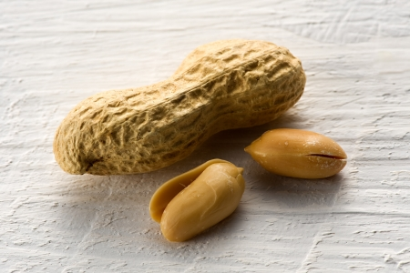 monkey nut: Whole peanut or groundnut in its shell together with two roasted peanuts served as snacks or used as an ingredient in cooking or for its oil