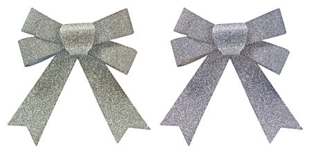 overtone: Two silver glitter decorative bows, one with a gold overtone, for use as packaging or as a party decoration for Christmas or a festive occasion, isolated on white