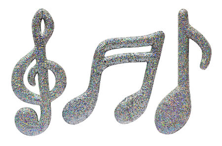 semiquaver: Silver glitter music notes used as festive decorations for a party or Christmas with a clef, quaver and semi-quaver isolated on white Stock Photo