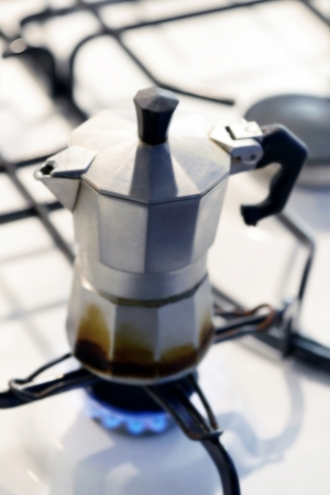 percolator: Coffee percolator on a gas hotplate brewing a strong cup of espresso or percolated coffee for an energy filled start to the morning