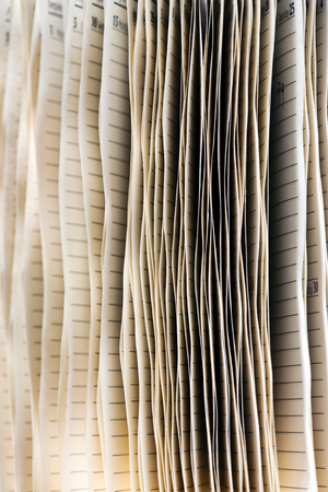 splayed: Background texture of the splayed edges of the pages of a diary used to schedule appointments in an office or keep a record of personal daily life