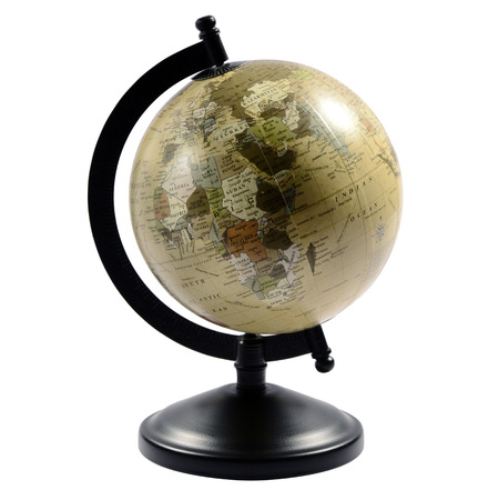 Old globe on a black stand with the countries in monochromatic shades of brown, isolated on white Stock Photo