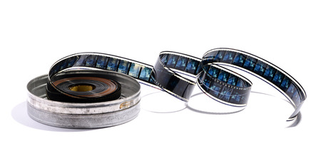 cine: Roll of cine film in a metal canister with a length of the film uncoiled to show the individual frame detail, on a white background