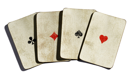 vintages: Set of four vintages aces from a deck of playing cards with dirty grimy surfaces and a simple design showing just the suite in the centre